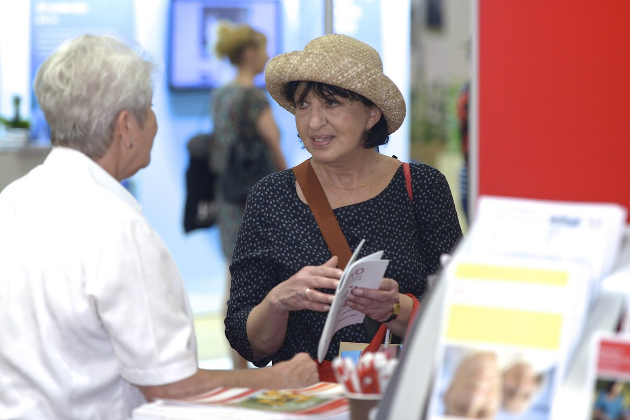 A woman standing at an exhibition stand