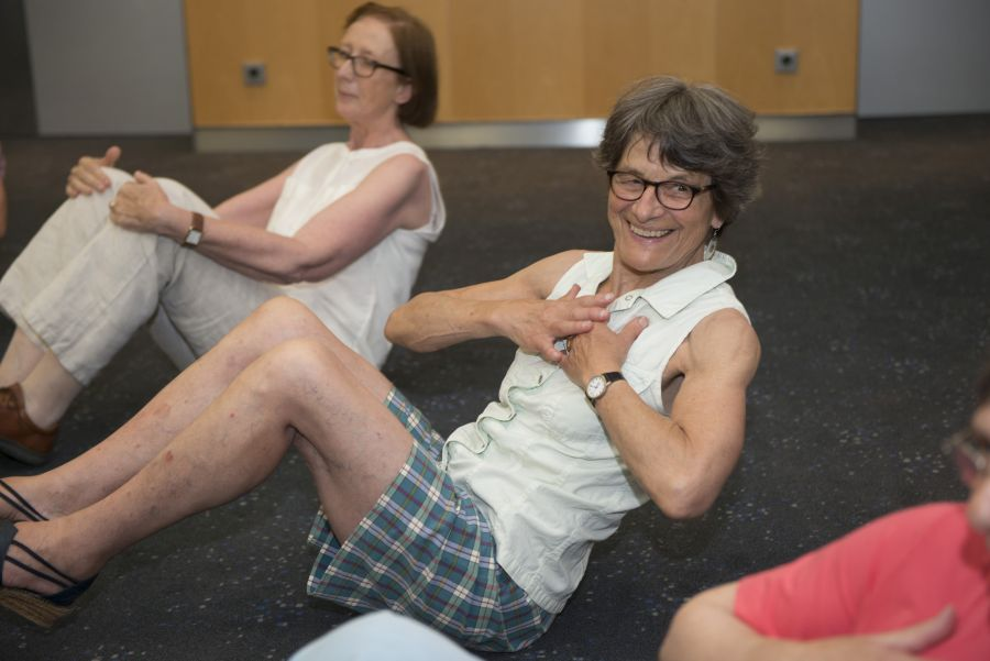 Two women doing sport exercises on the floor