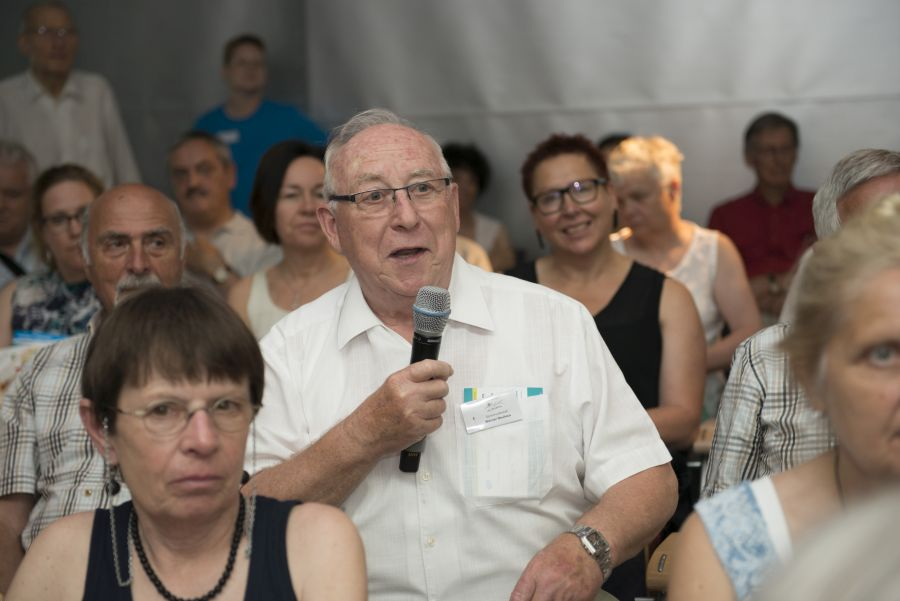 Man from the audience asking question during an event